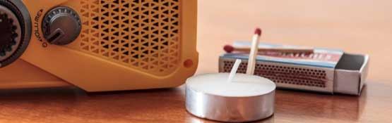 Emergency radio, matches and candle